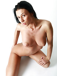 Busty brunette posing and making exercises being naked