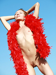 Skinny and petite redhead Kesy posing naked with the red boa