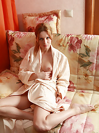 Sexy redhead with the big clit taking off her home gown and panties