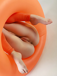 Redhead babe in orange outfit with the orange huge balloon