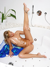 Tori Rubs Down with Baby Oil for Bottle Insertion