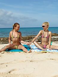 Bikini Babe Franziska Licks Blue Angel's Snatch on a Beach
