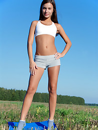 It's a sultry HOT summer day and super-cute 18 year old Sandy does her morning workout in the nude!