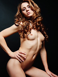 A beautiful brunette plays with her clear dildo
