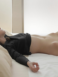 Imagine coming home from work early to find this long-legged brunette playing with herself in your bed!
