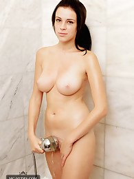 Jennifer takes a warm shower to relax after a hard working day. This beautiful girl has stunning breasts and a gorgeous round butt.
