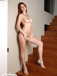 Kami exposes her fabulous curves on the stairs to her bedroom. Get together and enjoy her perfect breasts, round butt and soft skin.