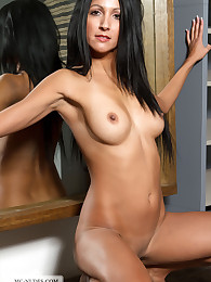 Keila exposes her nicely tanned and sexy body in front of the mirror. Watch this cutie from all sides, fully nude and hot.