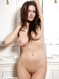 Busty Marjana shows off her big breasts for you. Check her out and see what she else has to offer for you.