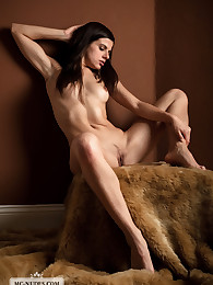 Cute Julia poses on fur and enjoys the tickling feeling it causes on her skin. This babe is really flexible.
