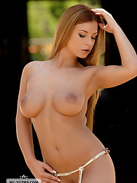 Busty Dora presents her incredible curvacious body. That babe is stunning and will turn your imagination on.