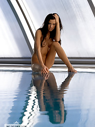 Zoe enjoys to be alone at the pool, stretching her body and preparing herself for some wet fun. Zoe is wonderful and will enlight your day with her appearance.