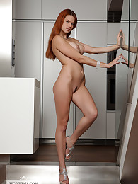 Kami is a lovely redhead with big breasts, a perfectly shaped butt and mesmerizing eyes. You will love her for sure.