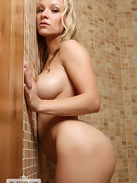 Voluptuous Daisy is taking a little shower. Join this hot blonde and enjoy her big breasts, round butt and great moves.