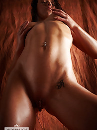 Cassandra exposes her athletic and shimmering body and allows some great views on her curves. Check her out and get your erotic dose.