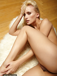 Gorgeous Colette is lolling her nicely shaped body on fur and exposes her sexy breasts and round butt just for your eyes.