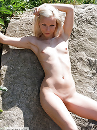 Allison is young, blonde and incredibly sexy. This pale beauty enjoys a lovely summer day in her garden and relax in the sun, fully naked.