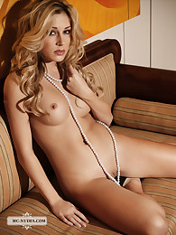 Blonde Jenny exposes her fine pair of breasts and sportive body just for you. This babe is plain beauty.