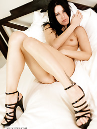 Anika has gorgeous long legs and relaxes on her bed. You shouldn't miss her or you will bite yourself in the ass because of it.