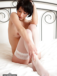 Camilia is a sexy, short haired babe with a sportive body and round butt. Join her and see her presenting herself as a little, fully naked and sensual gift.