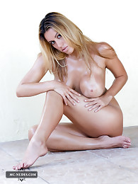 Busty Megan exposes her big pair of squishable breasts and spreading legs. This girl is having all you need for your imagination.